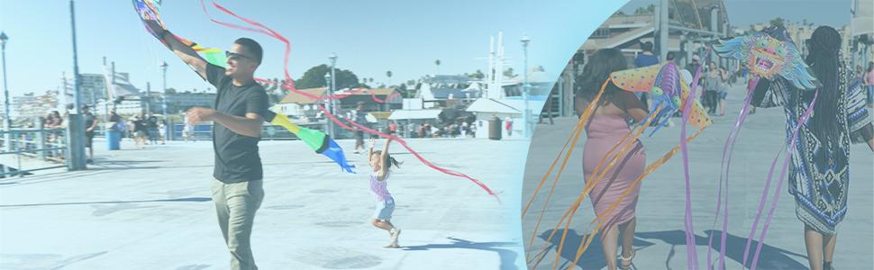 X Kites banner, families enjoying in beach with X Kites