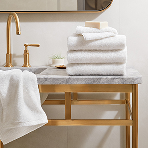 H by Frette Folded Towels on Bathroom Counter