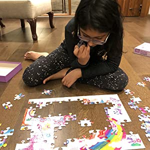 Puzzle play helps children develop fine motor skills. Unciorn puzzle for girls by Chalk and Chuckles