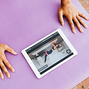 Booty resistant bands in workout video on iPad, showing resistance bands women use
