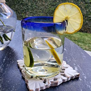 Cobalt Blue Rim Tumbler with ice, water and slices of lemon and lime