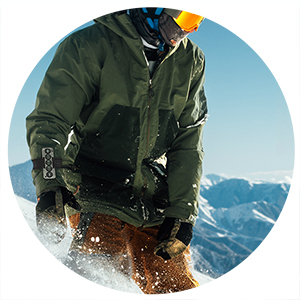 Snowboarder wearing Chubby Buttons 2: The wearable/stickable bluetooth remote action sports