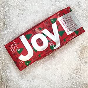 Joe Knows Coffee. Joy Peppermint Bark. Bright merry  holiday packaging. Mint flavored gourmet coffee