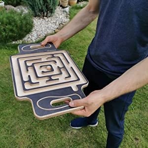 Labyrinth balance board in hands