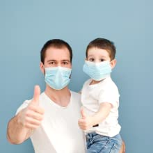 kid and dad with mask thumb ups