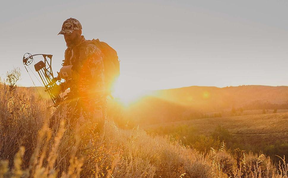 man hunting during sunset