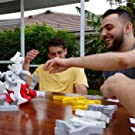 friends playing Quaggle balance game together in backyard