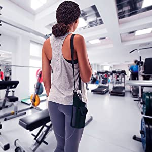 woman in gym with neoprene bottle carrier and cell phone holder