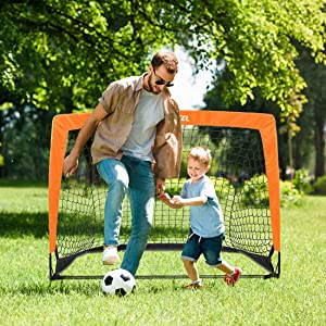 Dad play soccer with kid boy