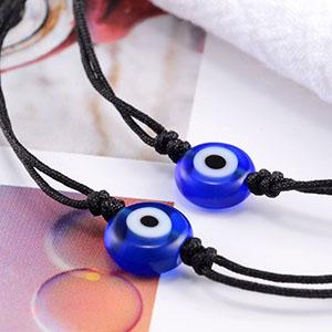 2 black string evil eye bacelets