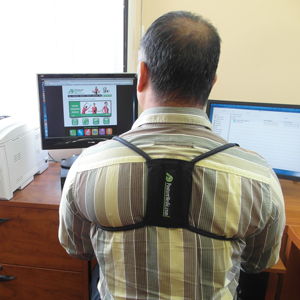 Man working on computer with Posture Medic