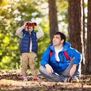 Little Boy with Dad looking through binoculars