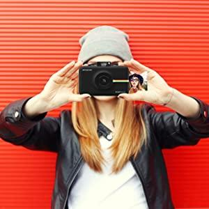 young adult taking photo with camera