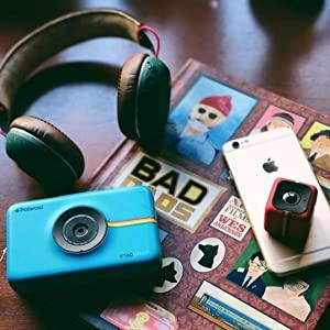 Blue camera video cube cam and earphones on table