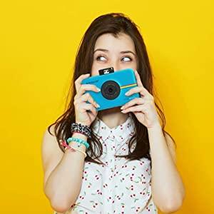 young adult using blue camera