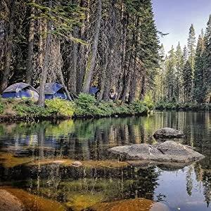 Tents beside a stream
