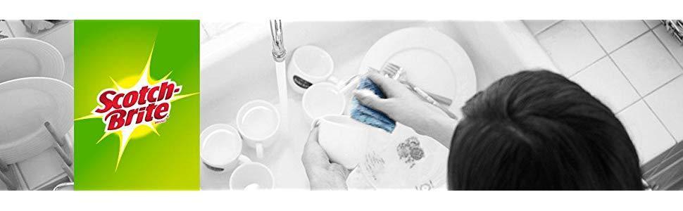 Scotch-Brite Non-Scratch Scrub Sponge Cleaning sink full of dishes