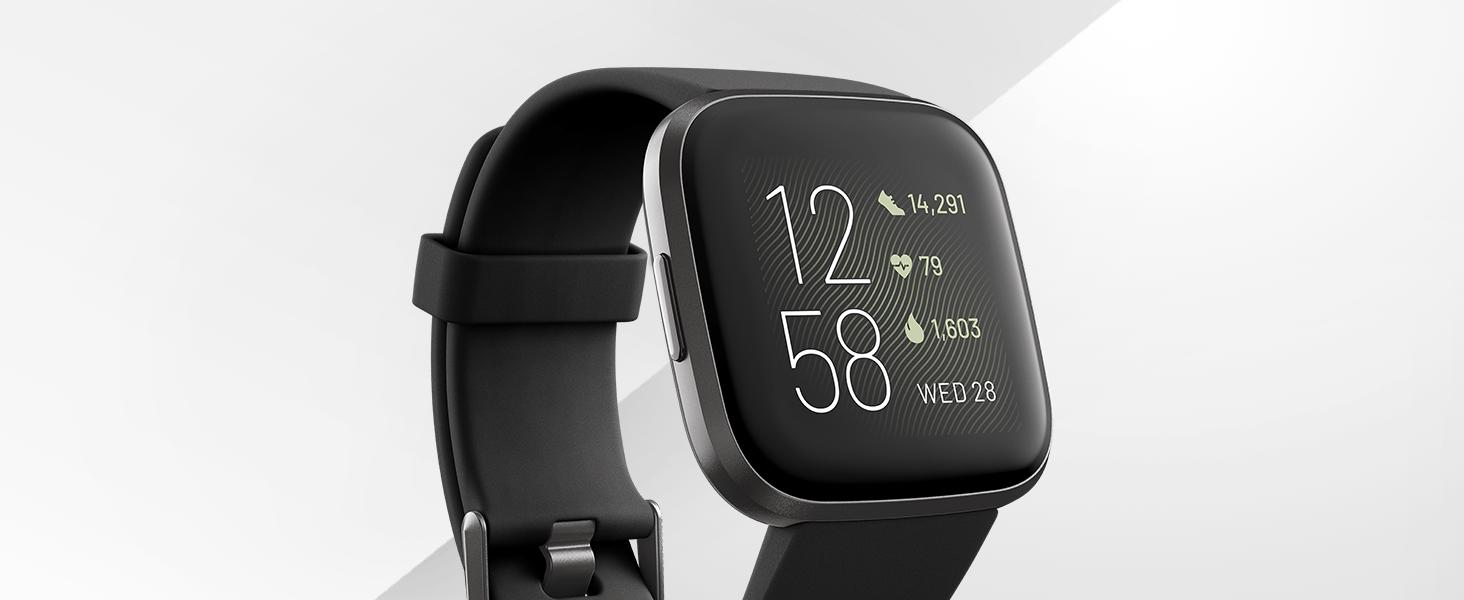 fitbit Versa 2 watch with black wristband and clock displayed