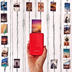 red zip photo printer with zink photos hanging