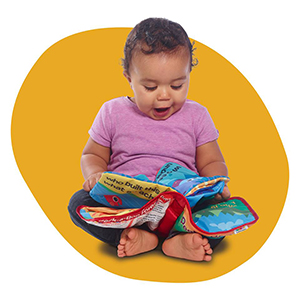Baby enjoying Lamaze Peek-A-Boo Forest Soft Book