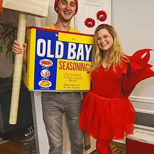 Young couple dressed as a tin of OLD BAY seasoning and a crab for Halloween Costume
