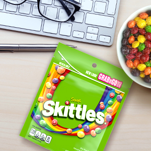 Enjoy your favorite sour candy at your desk with Skittles Candy office snacks.