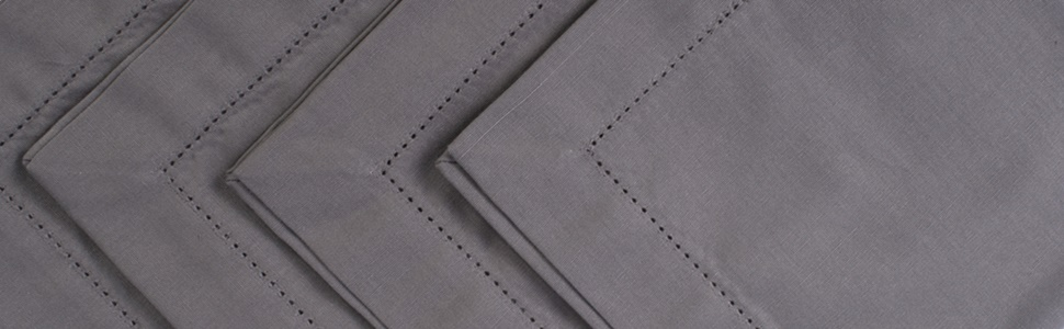 Close up detail image of the hemstitch detail on the 6-piece placemat set in the color gray.