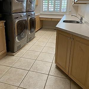 Plain laundry room wood laminate tile floor before rehab refresh transform