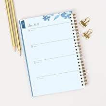 blue sky bakah blue academic planner,closeup of weekly layout,desk setup with scissors and pencils