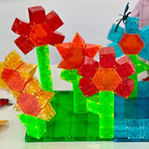 Magna-Qubix Magnetic building blocks used to build several flowers