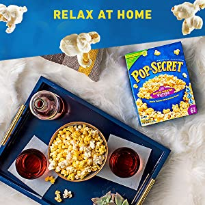 Bowl filled with POP SECRET Microwave Popcorn served on a tray