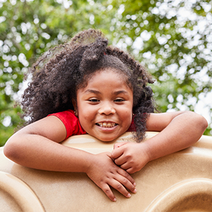 girl playing on a playground