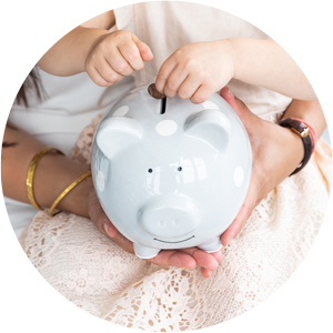 Image of mom and child putting coins into piggy bank.