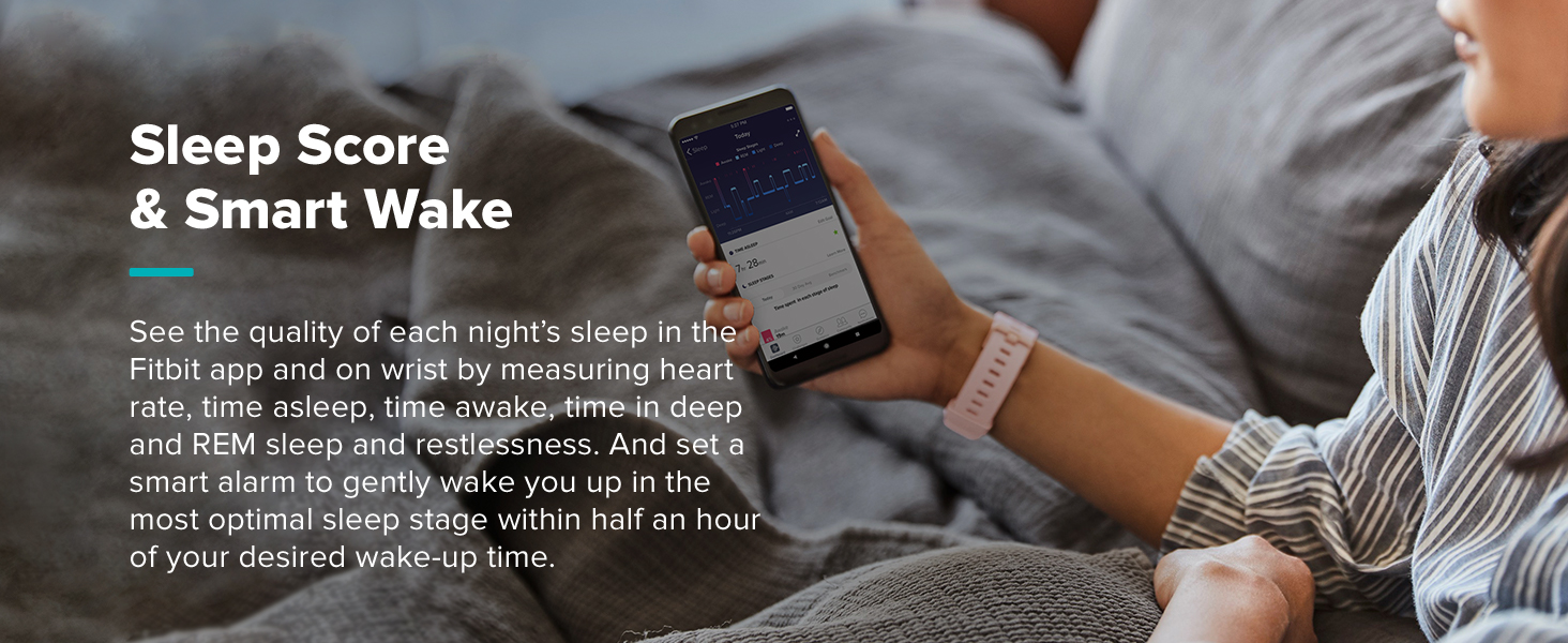 Woman looking at sleep tracking screen on smart phone