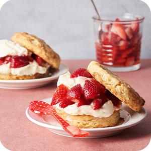 Image of strawberry shortcake, with fresh strawberries.