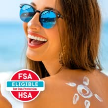 Woman smiling at the beach - Face and body mineral sunscreen can be covered by FSA & HRA accounts