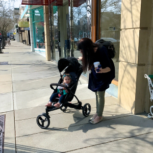 one child with compact stroller