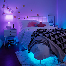 Kids bedroom with purple and blue lighting