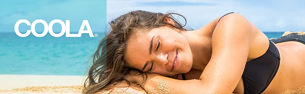 girl laying on beach with coola logo