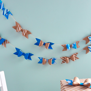 Blue and kraft brown bow garland made from Hallmark wrapping paper with DIY gift bow templates