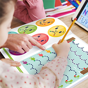 a preschool girl working on a workbook