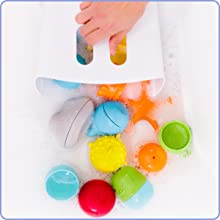 Hand grips toy drying bin by handle, scooping up Ubbi bath toys from soapy bathwater