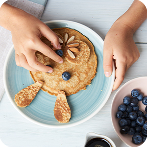 Plate of pancakes decorated like a bunny rabbit