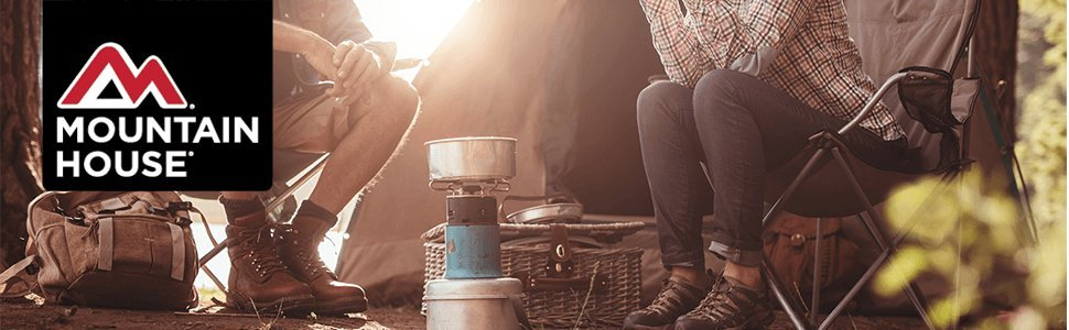 Mountain House banner image with two people eating in outdoors camping setting