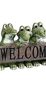 welcome signs, crocodile statue