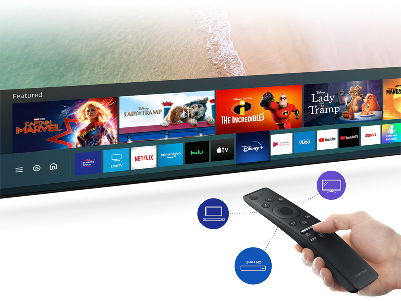 Someone using OneRemote to browse streaming apps on the QLED TV