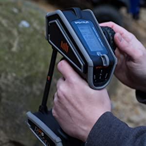 Close up of driver holding Spektrum DX5 Rugged RC transmitter