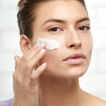 Gentle apply DermaControl Purifying Face Mask to clean skin.