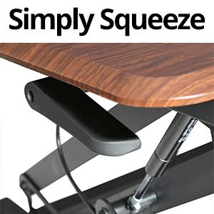sevilleclassics airlift standing desk converter pneumatic gas spring desk platform top wood brown