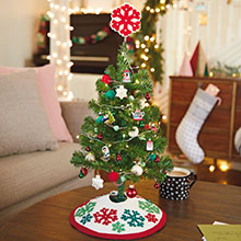 Mini Christmas tree with mini ornaments, lights, tree skirt and tree topper for small spaces